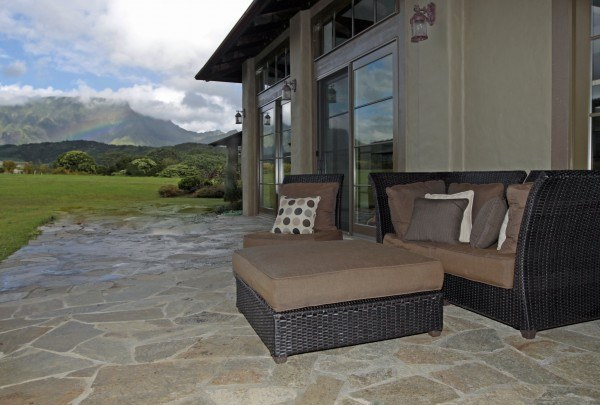 Outdoor stone patio with furniture