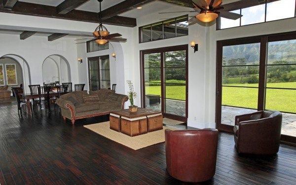 spacious living room with dark wood floors