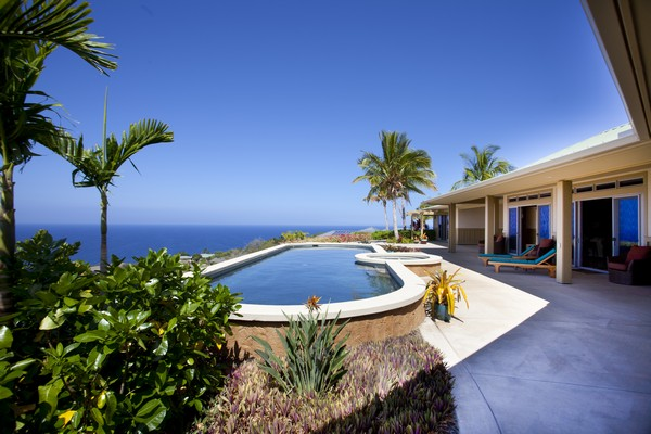 Infinity pool with ocean view at kohala ranch home for sale