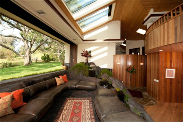 Lava rock waterfalls in great room, sky lights and pocket doors for sale in Ahualoa