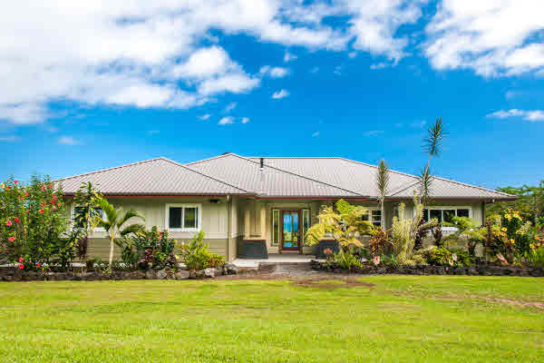 Newer home on acreage Hamakua with mac nut and barn