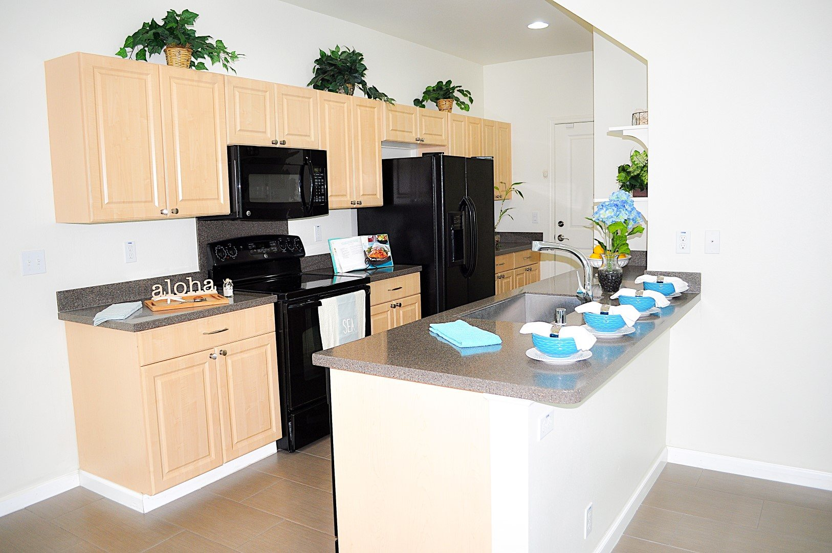 New Listing In Ewa By Gentry Laulani Trades Hawaii Real Estate -  kitchen sink and cabinet oversized