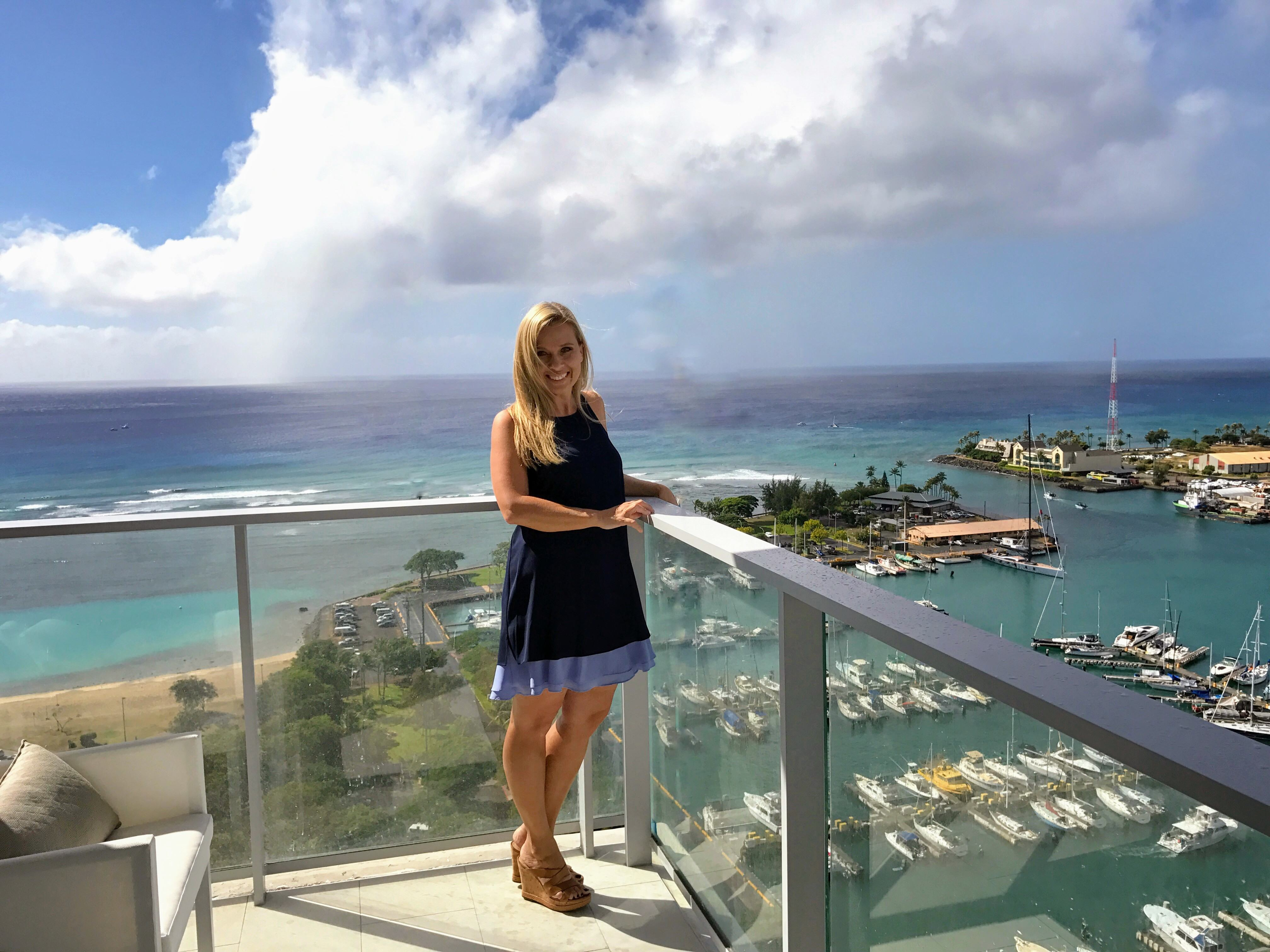 Kinga Mills at a showing in the heart of Honolulu's urban redevelopment, enjoying the ocean views.