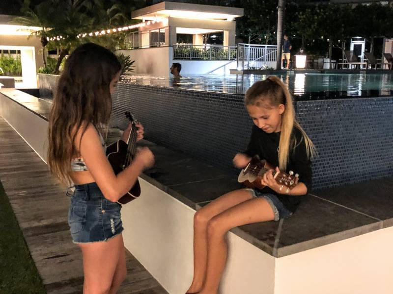 Kids playing Ukulele