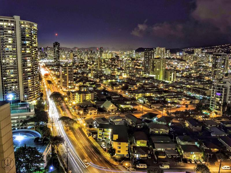 Waikiki/Honolulu city lights glimmer over Oahu