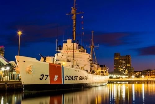 coast guard ship in harbor at dusk