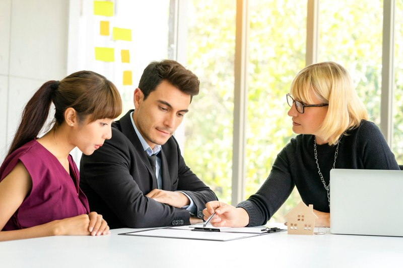 young couple meeting with mortgage lender