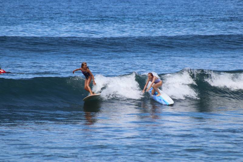 girls surfing on maui