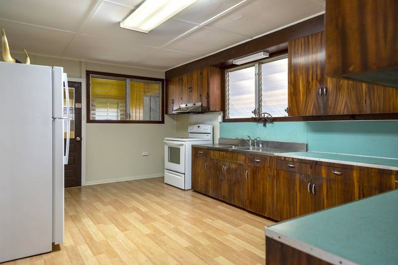 Turquoise formica and koa cabinets