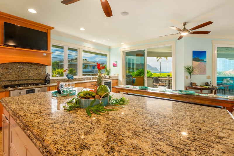 Photo of the kitchen, focused on the kitchen island with the view in the background.