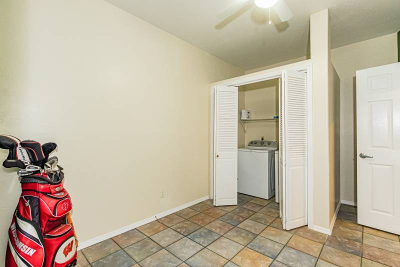 The mudroom, including a closet for the washer and dryer.