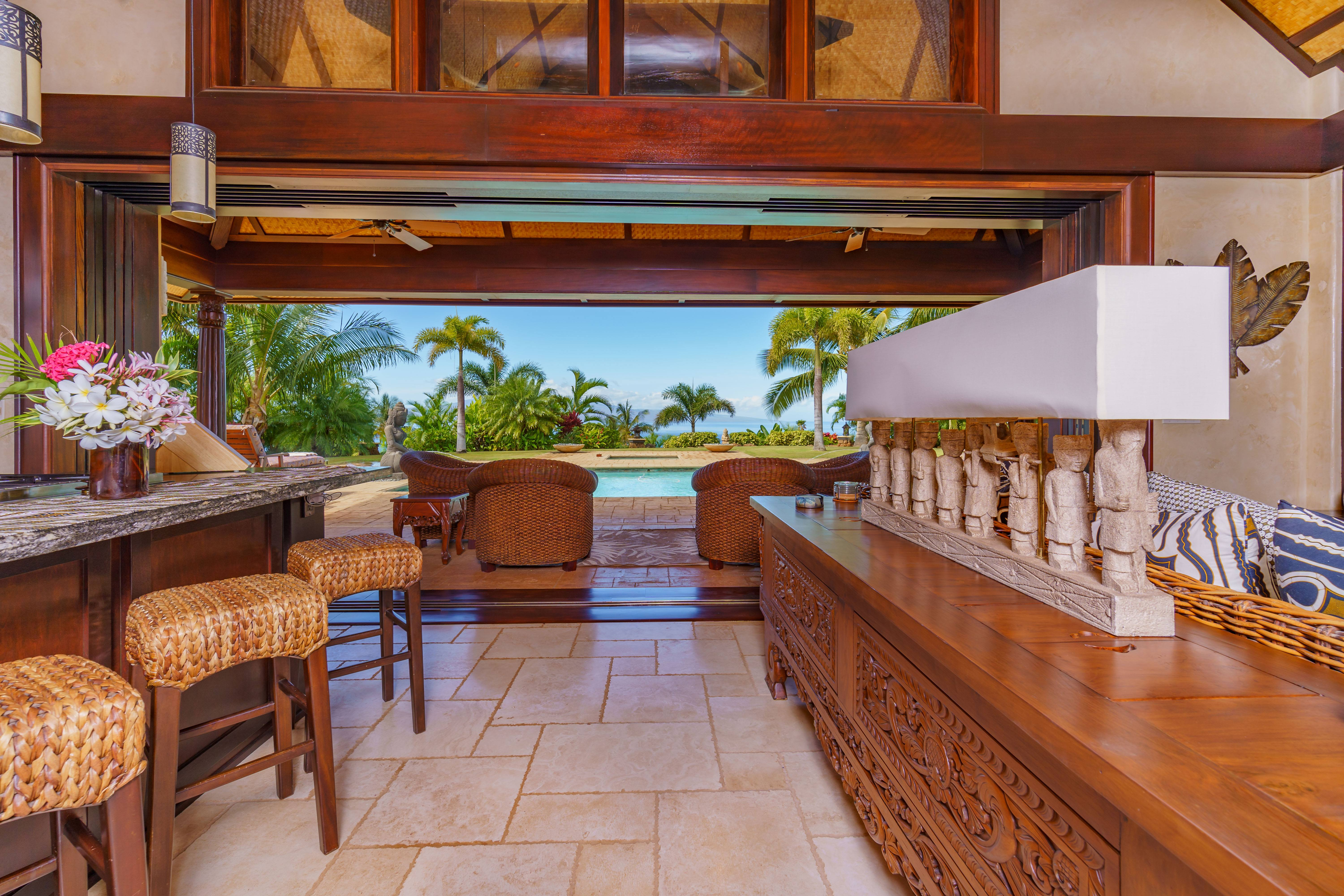 indoor-outdoor living space at Balinese-style estate in Launiupoko maui