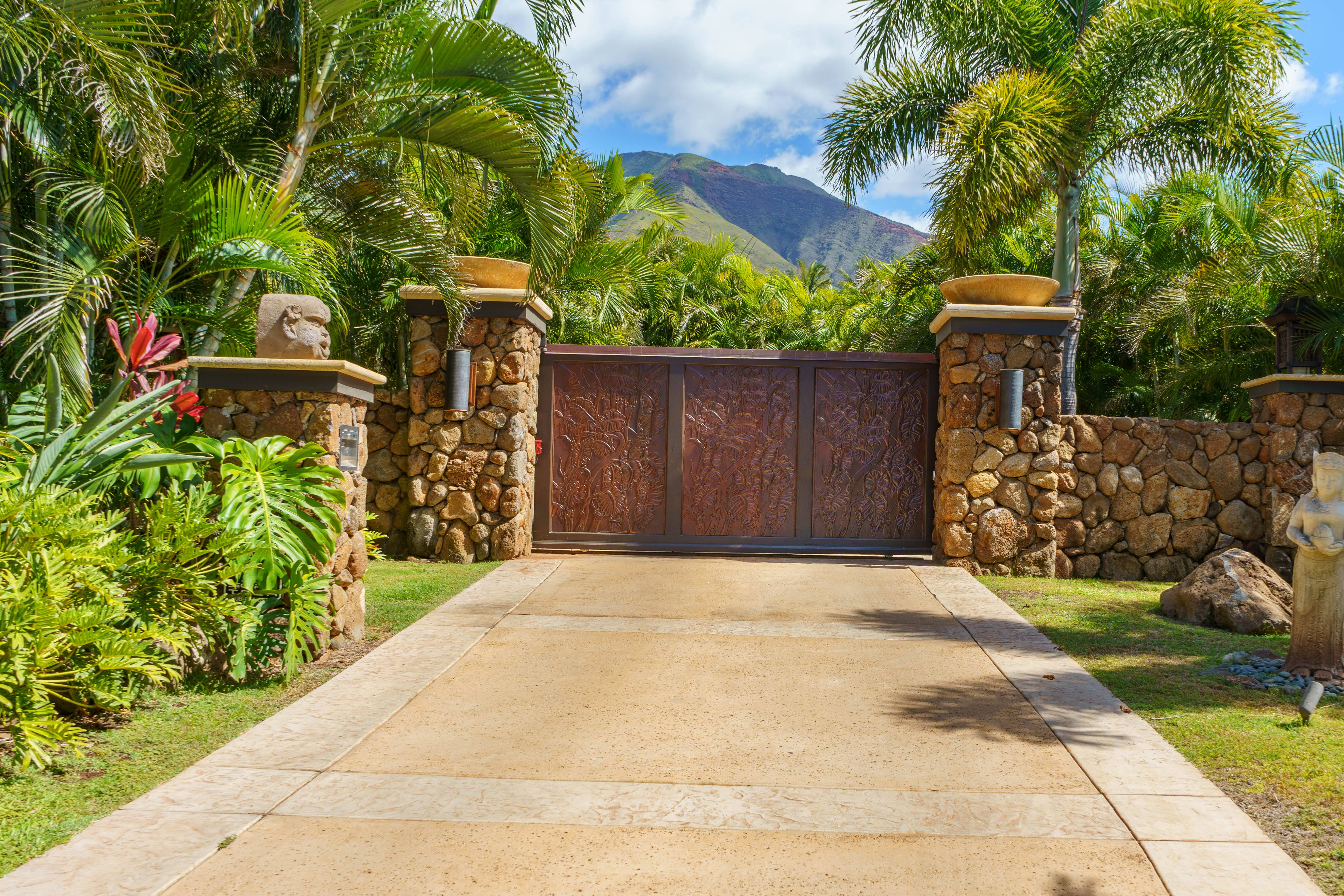 gate and driveway to Balinese-style estate in Launiupoko maui