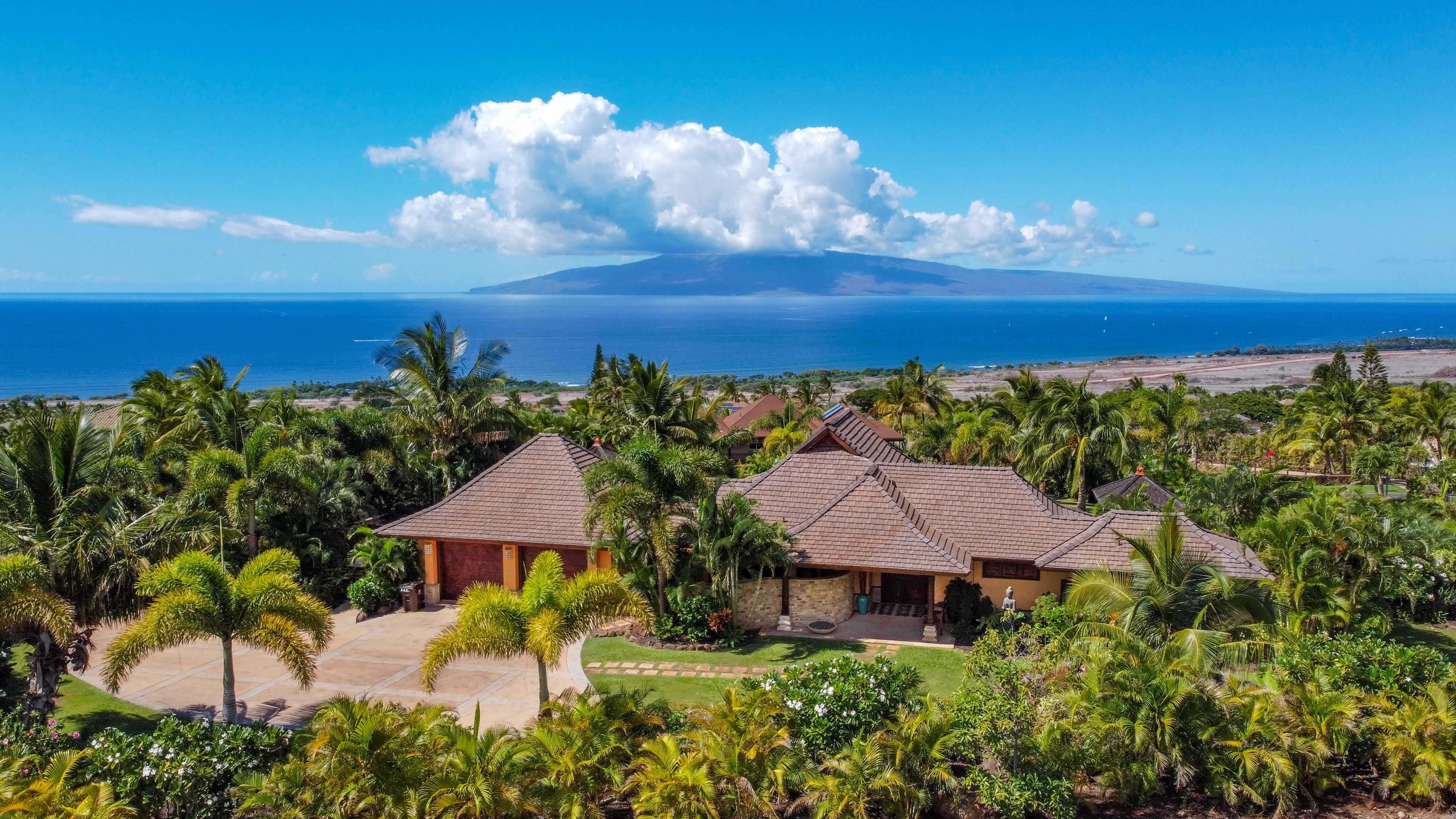 view of Balinese-style estate in Launiupoko maui with ocean in background