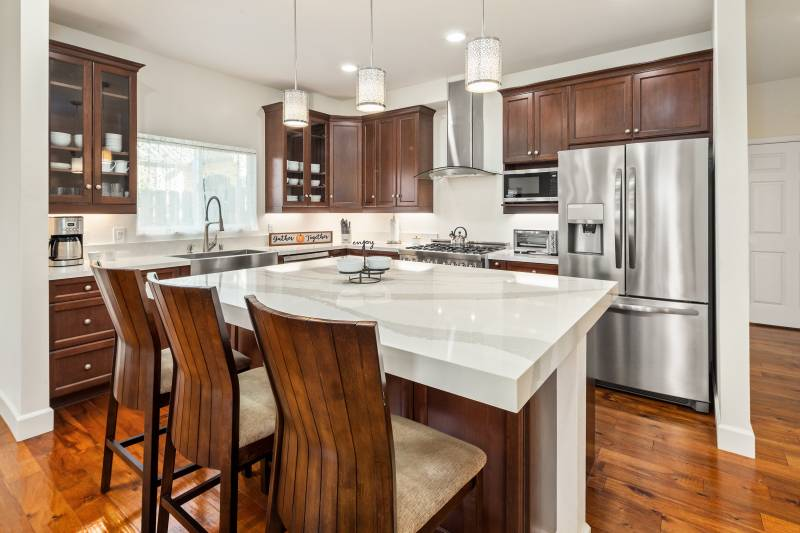 modern kitchen with wood floors and cabinets