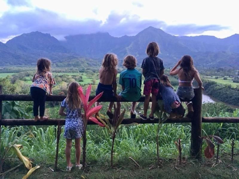 children look out at kauai mountain views
