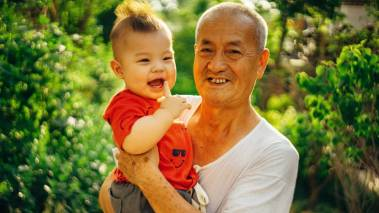grandpa with grandson on oahu hawaii