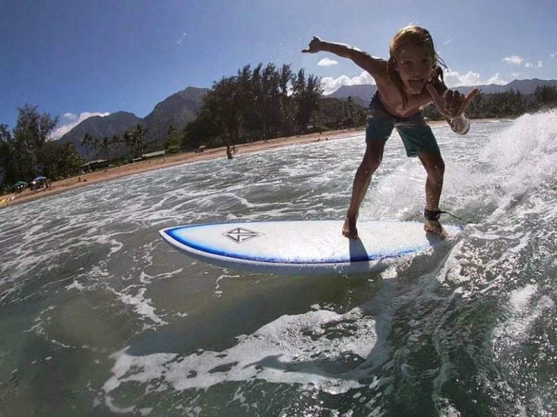 child surfing on kauai