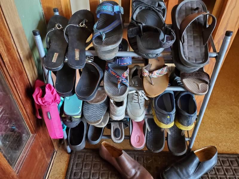 shelf full of shoes to wear in hawaii