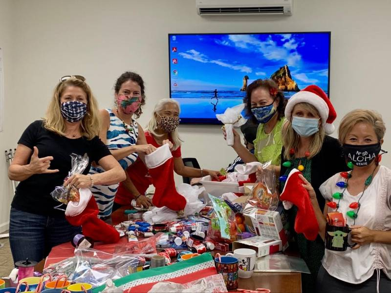 kauai real estate agents fill stockings for charity