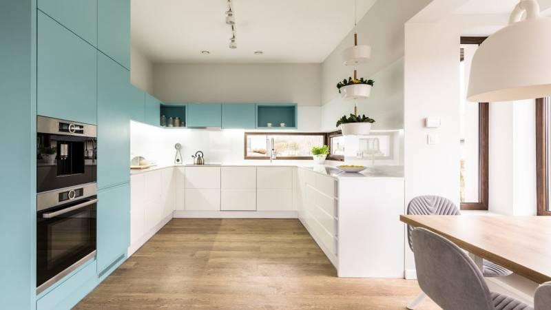 minimalistic white and light blue kitchen