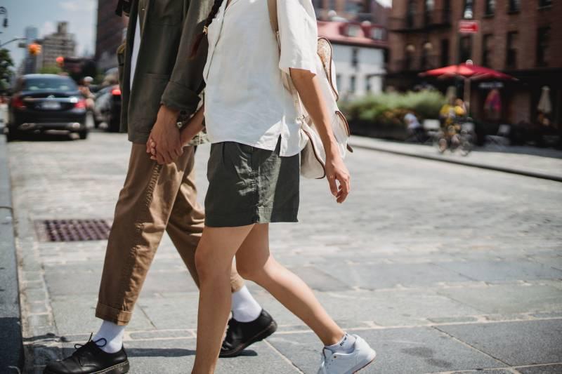 two people walking on street