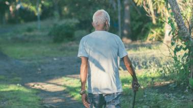 elderly man goes for walk oahu