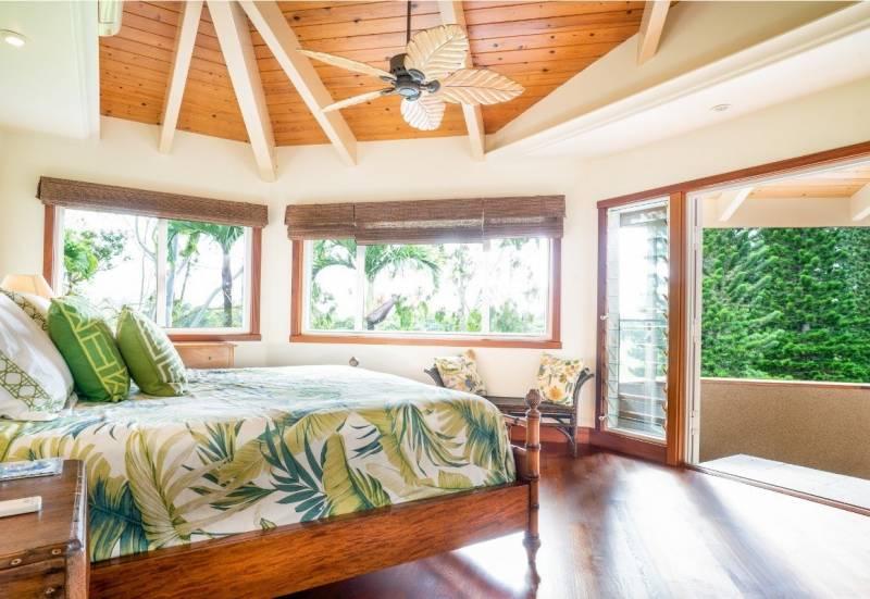 bedroom looking out on green backyard kauai
