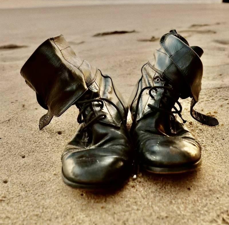 boots on hawaii beach sand
