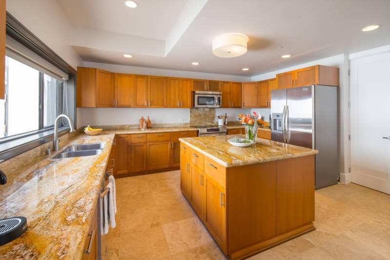 granite countertops in penthouse condo kitchen