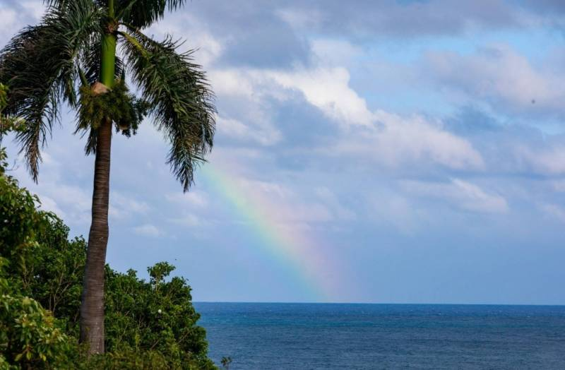rainbow over kauai ocean