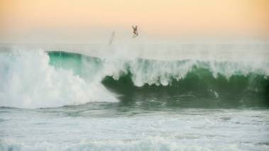 crashing on big wave on oahu