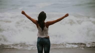 happy woman on hawaii beach