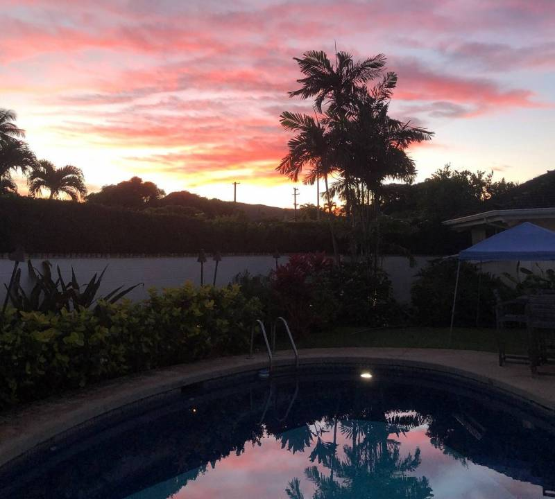 pool at sunset at home for sale on oahu