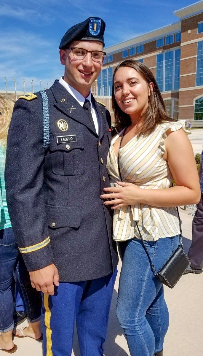 woman and military man pose together