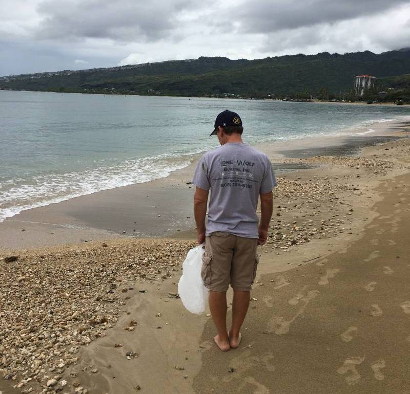cleaning up the beach in hawaii