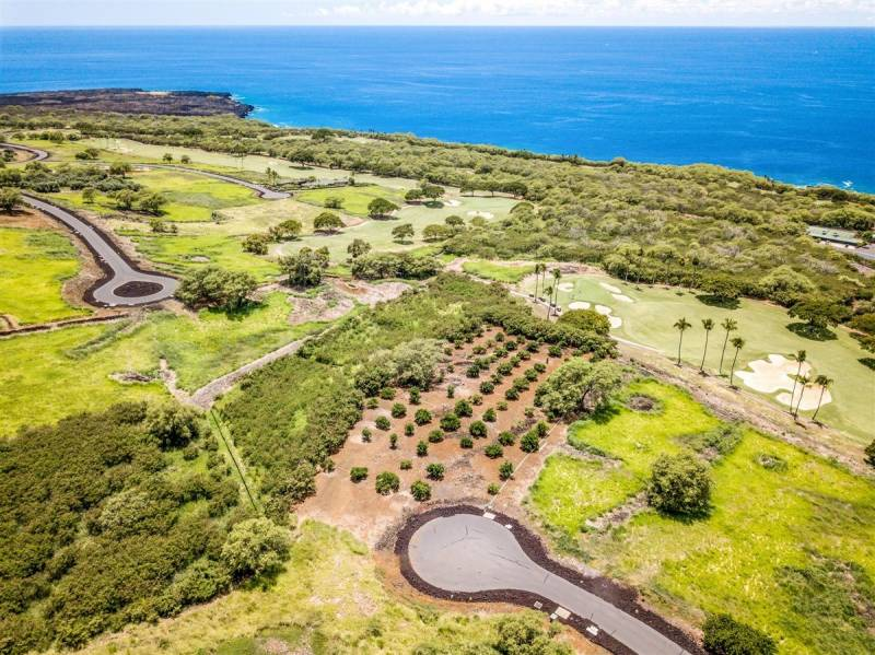 grounds of hokulia with golf course and ocean in view