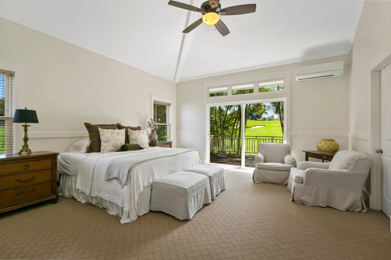master bedroom with door to lanai and golf course views