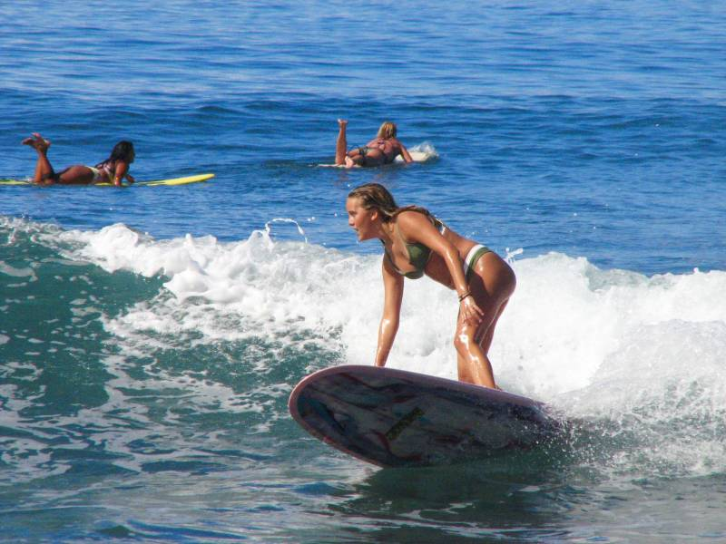 girls surfing puamana west maui