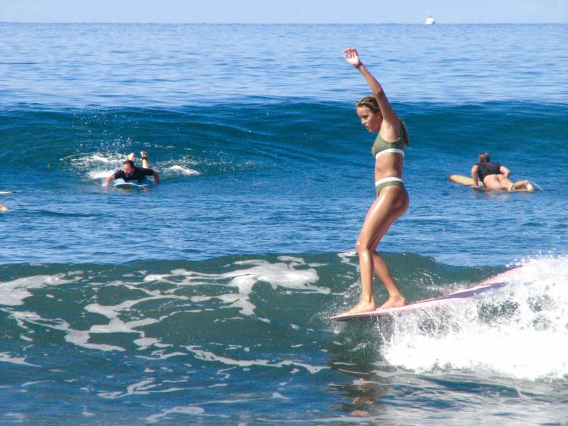 surfing the waves on maui
