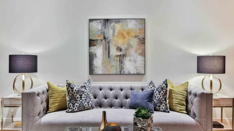 gray sofa and abstract art