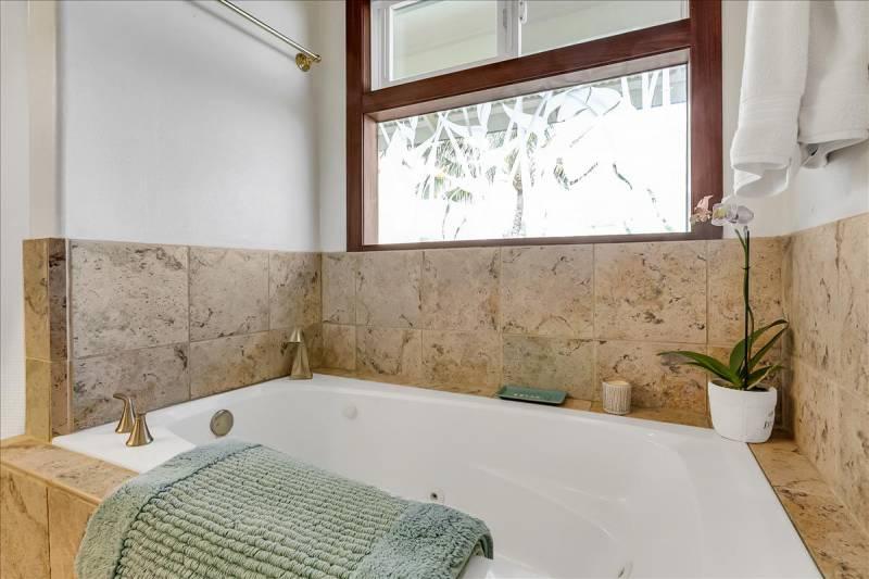 large, deep bathtub in master bath