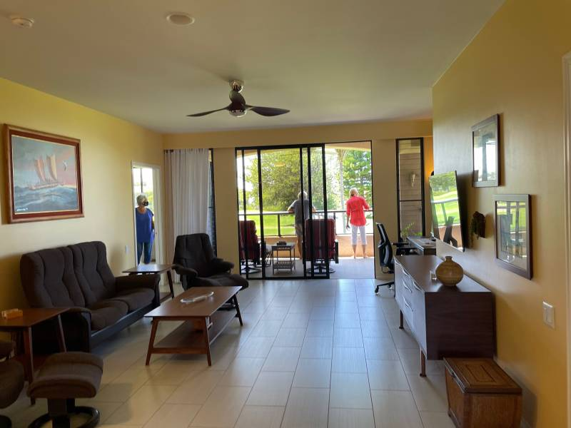 Socially distanced buyers view a listing at open house