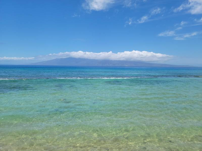 Blue-green water in front of Papakea