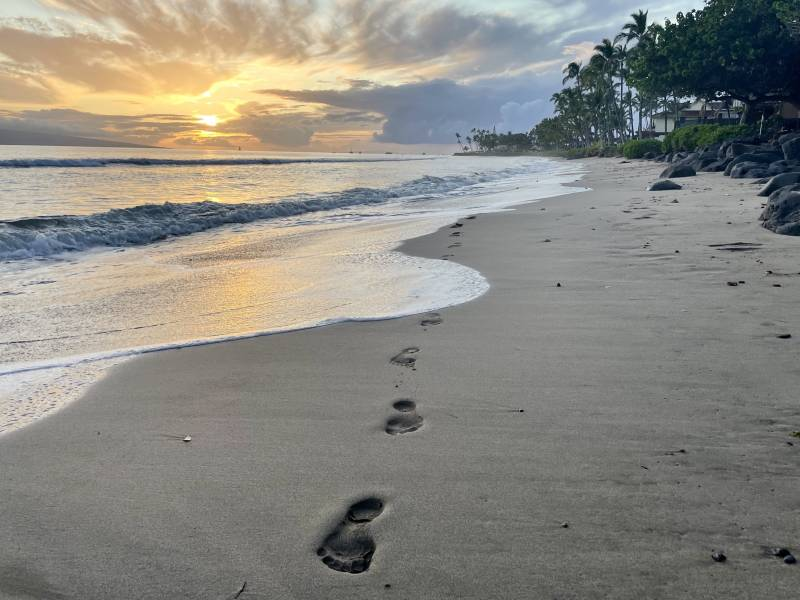 footsteps on the beach at sunset in puamana maui