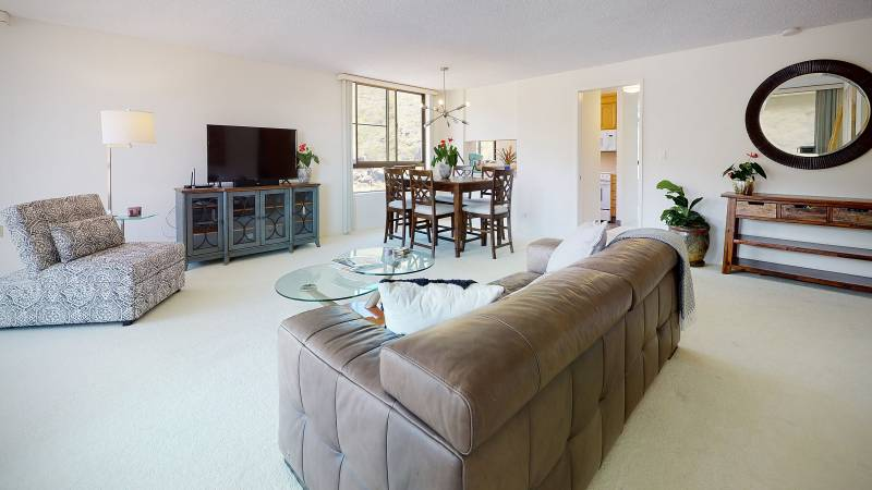 living and dining room at hawaii kai plaza condo for sale