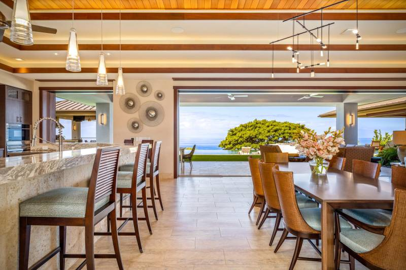 kitchen and dining area opens to lanai with ocean views