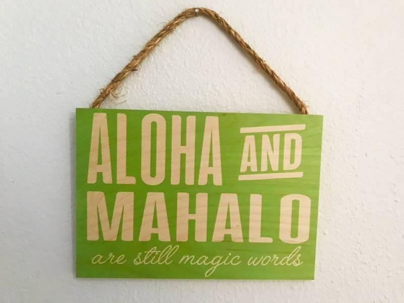 "sign reads ""aloha and mahalo are still magic words"""