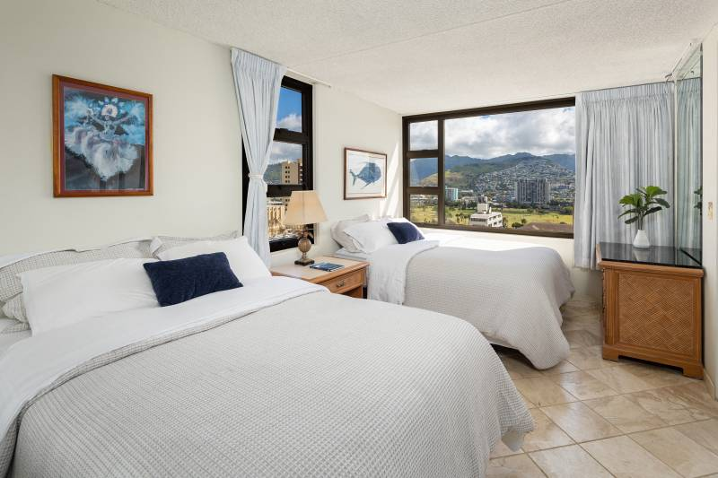 large bedroom with mountain views