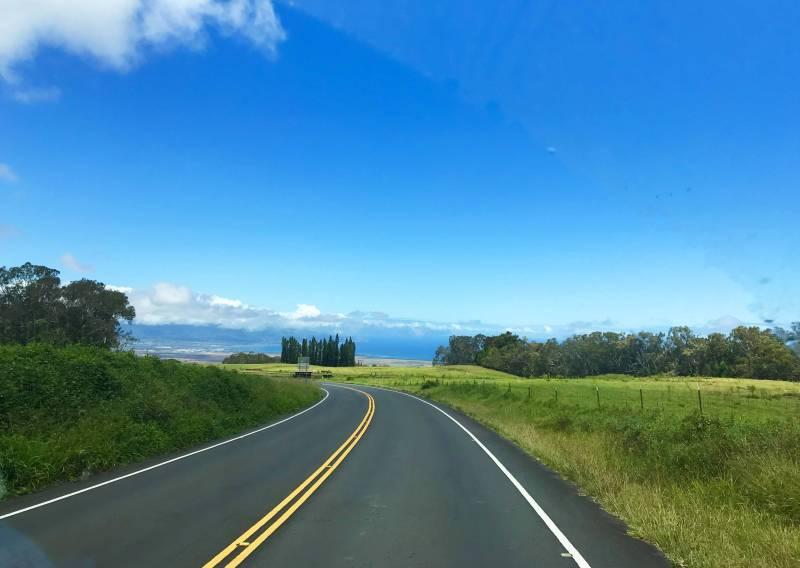 road leads toward mountains on maui